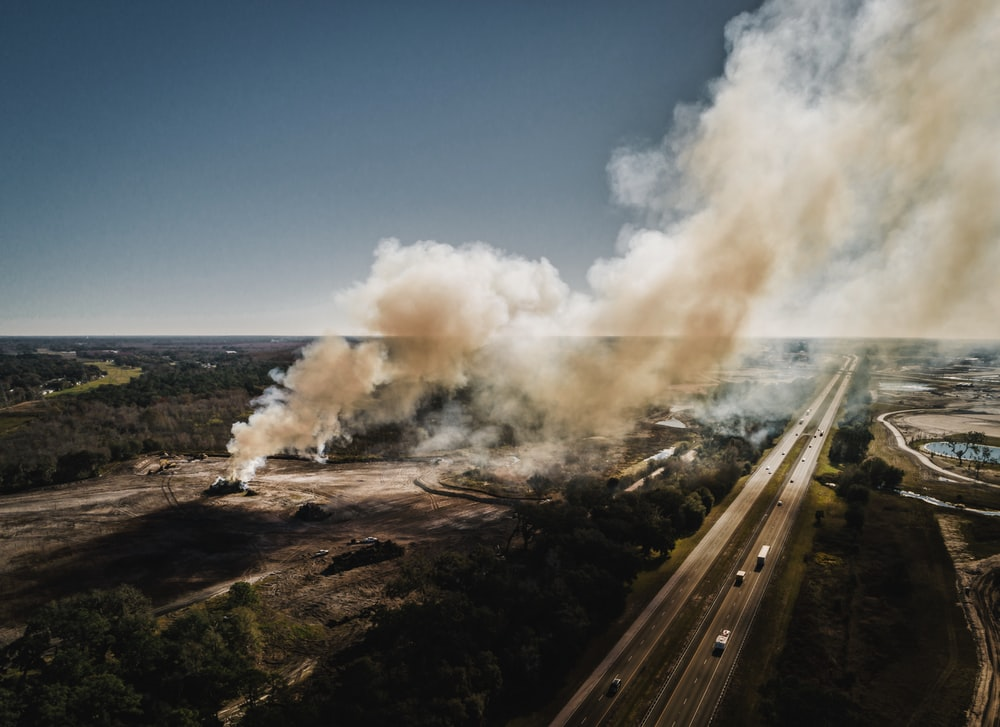 aerial photography of smoke near road