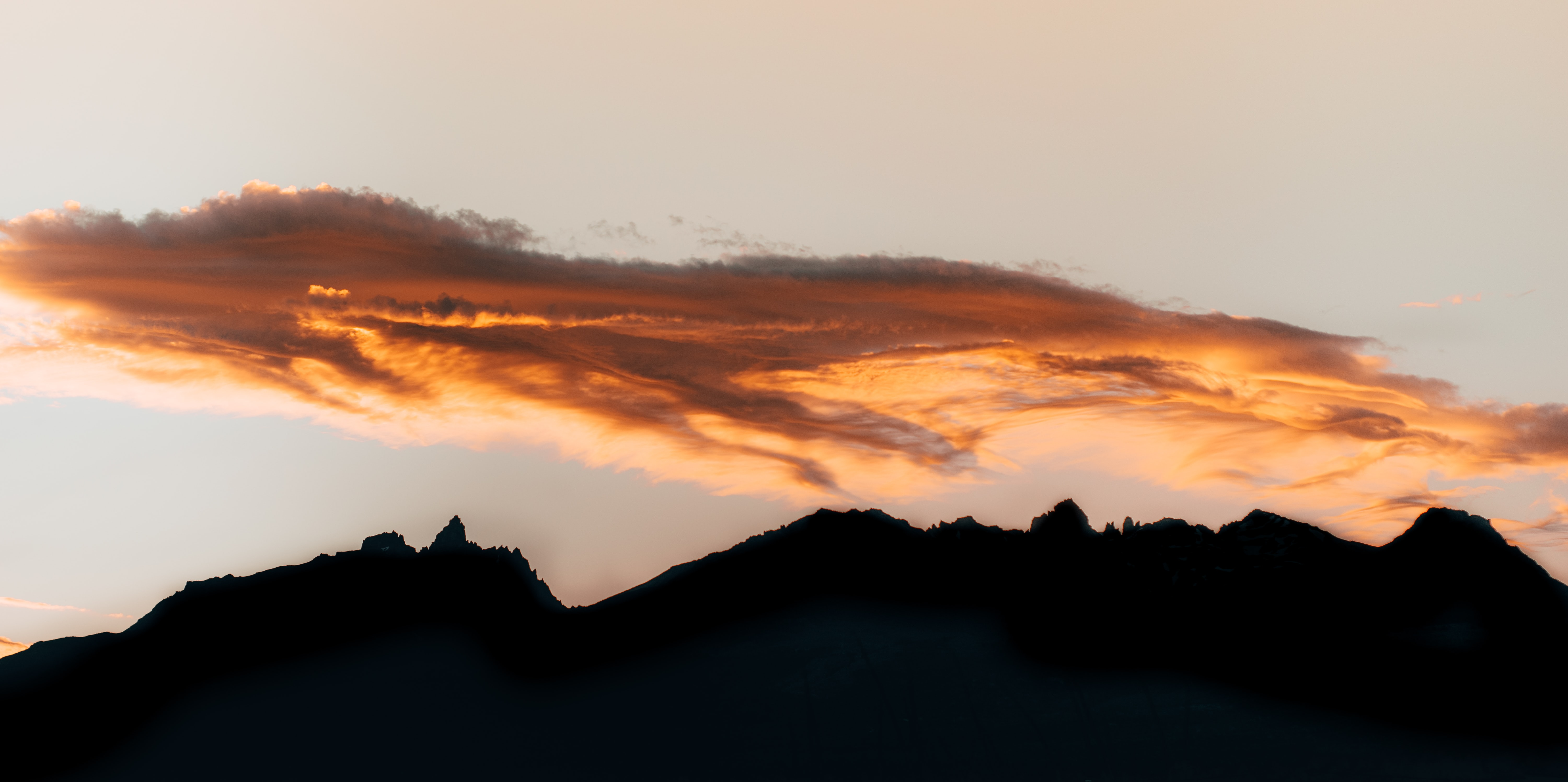 silhouette of mountain range under white clouds