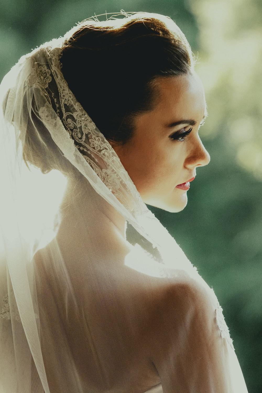 woman wearing white wedding veil