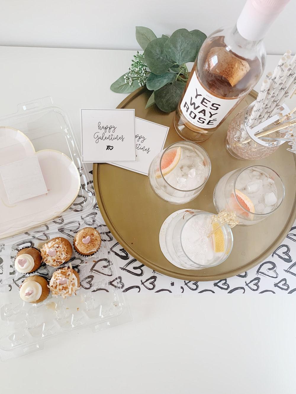 white wine bottle and goblet glasses