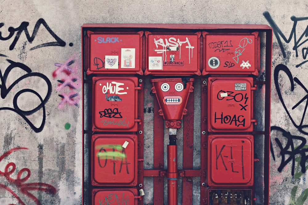 red metal box attaching wall