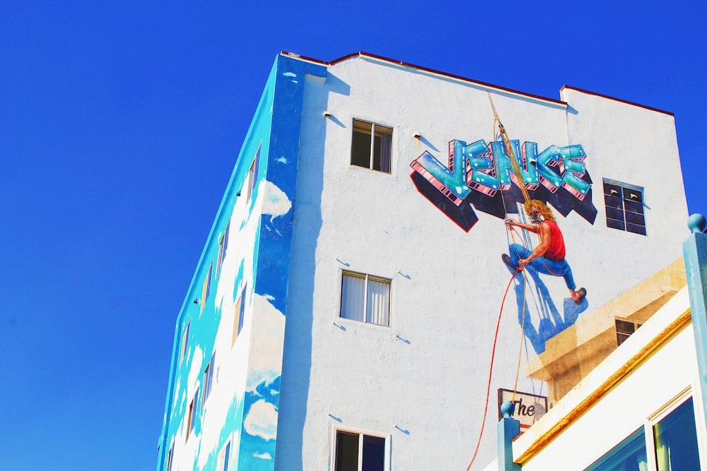 man putting Venice graffiti 3D art on wall