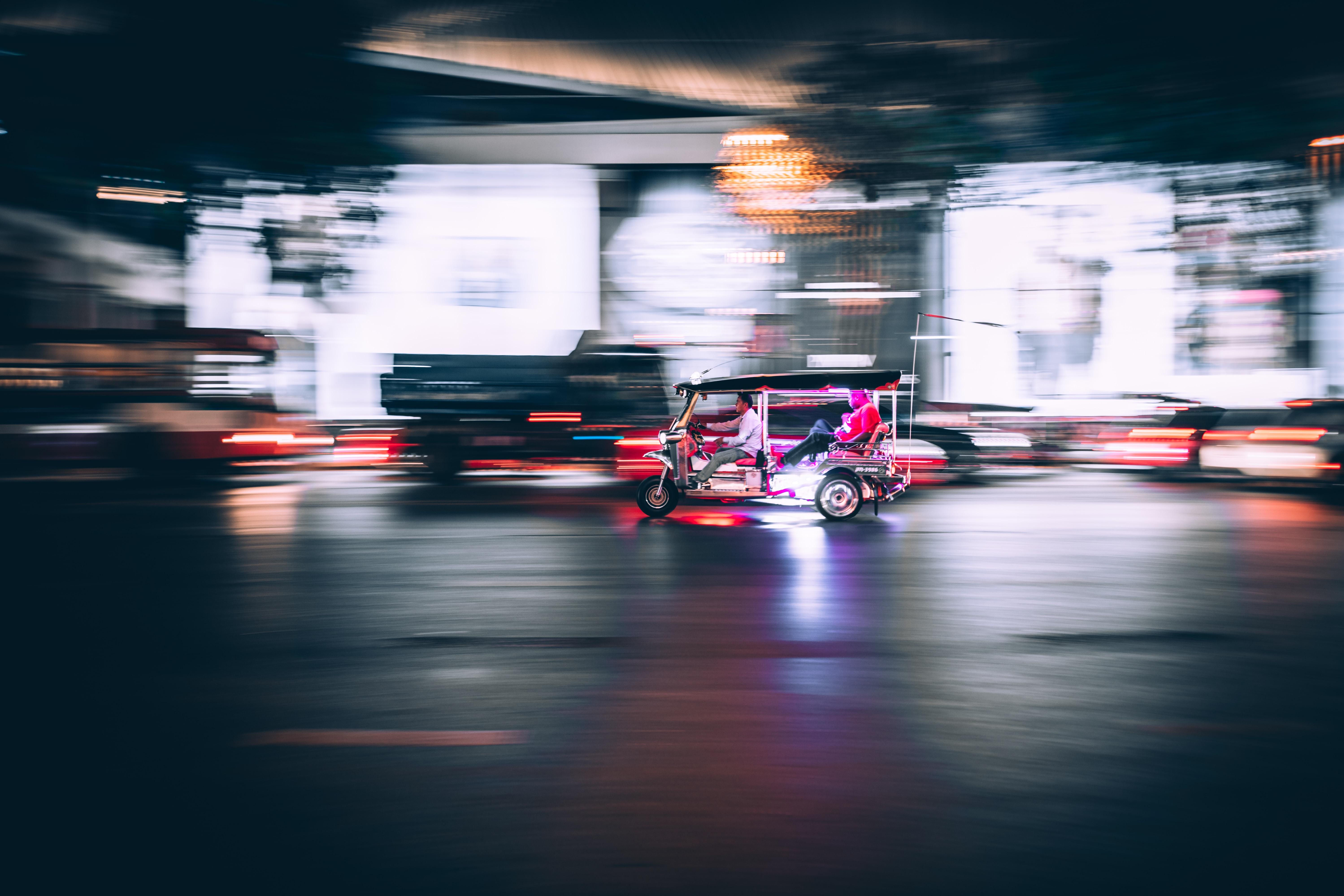time-lapse photography of auto rickshaw
