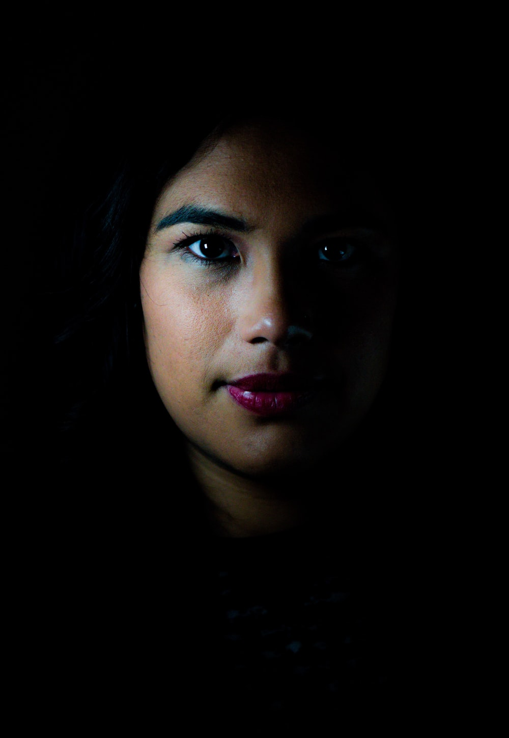 low light photography of woman