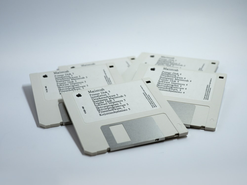 four MacBook diskettes