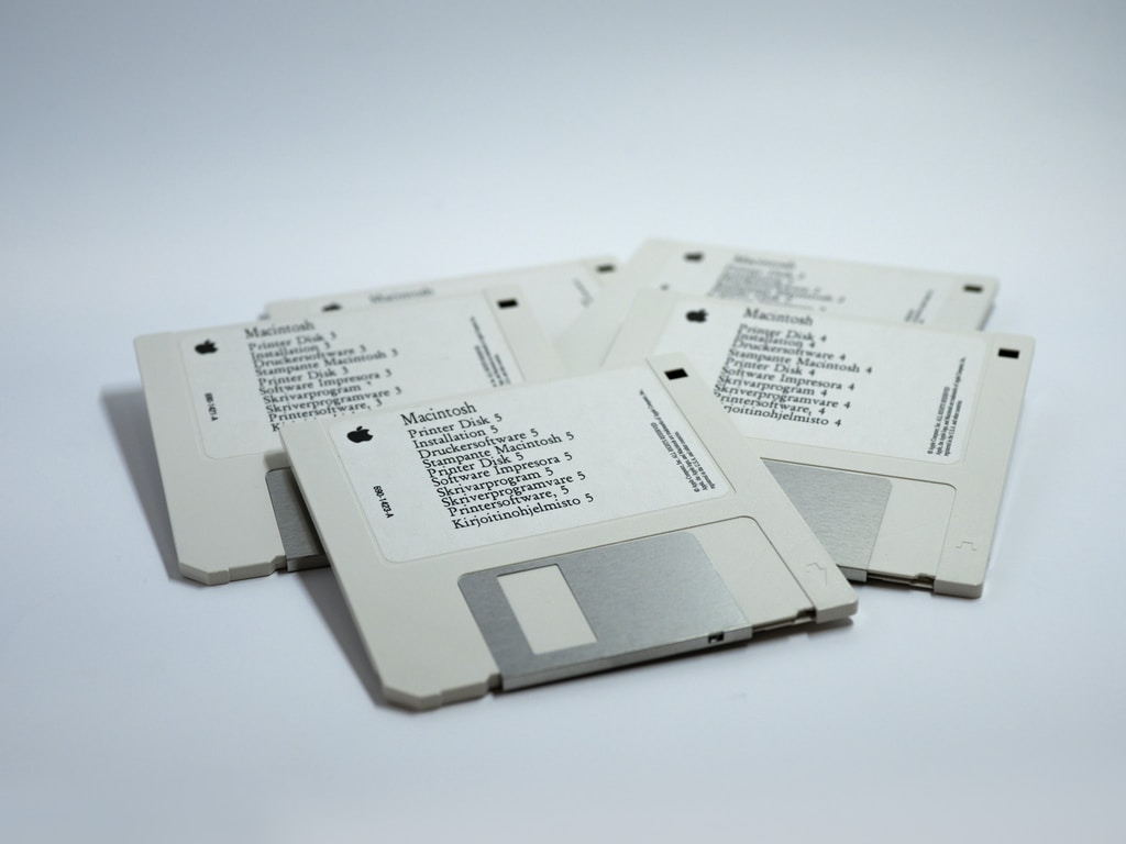 four MacBook diskettes