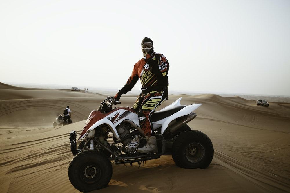 Man on ATV sand dunes