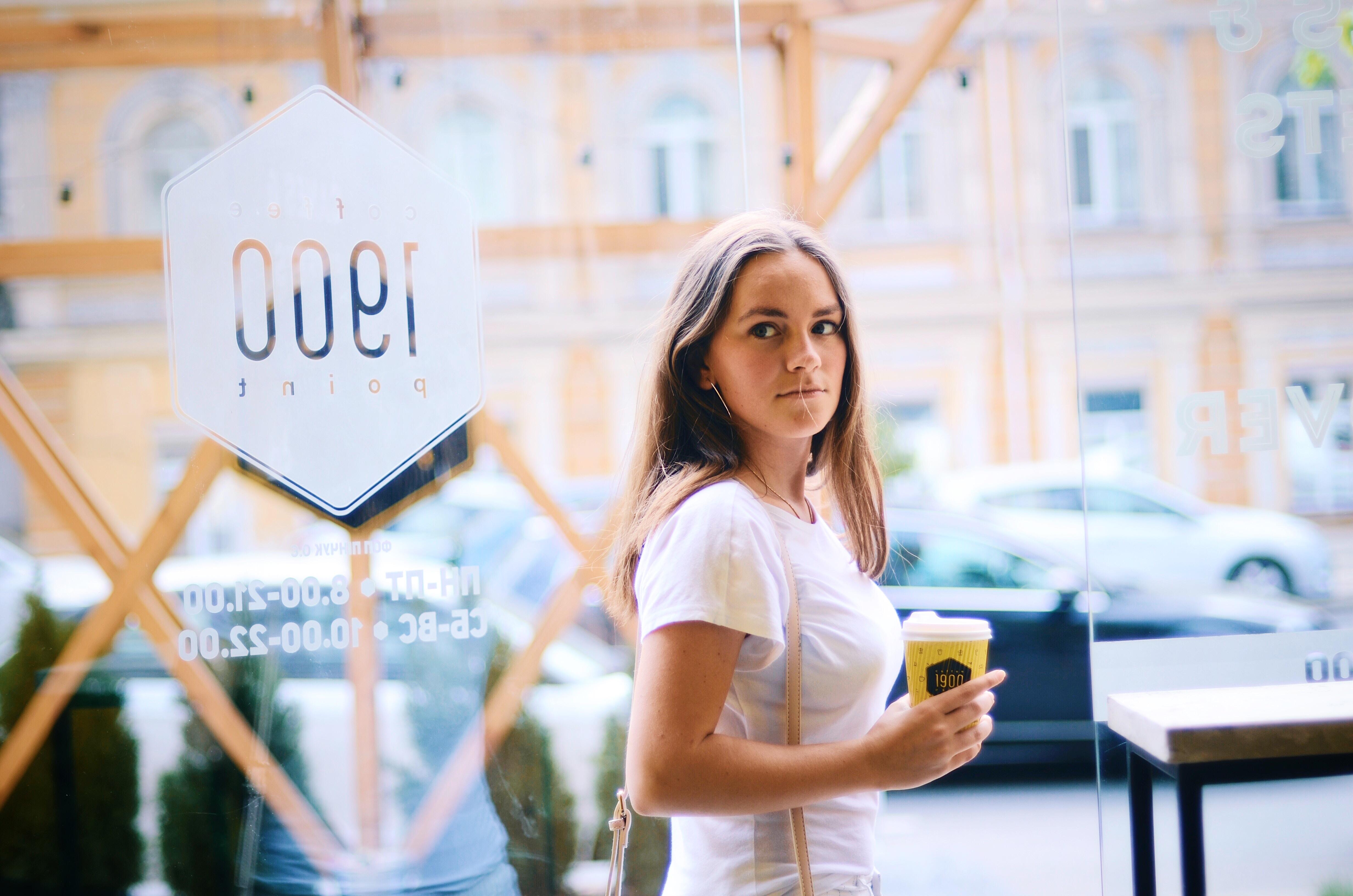 woman standing near door