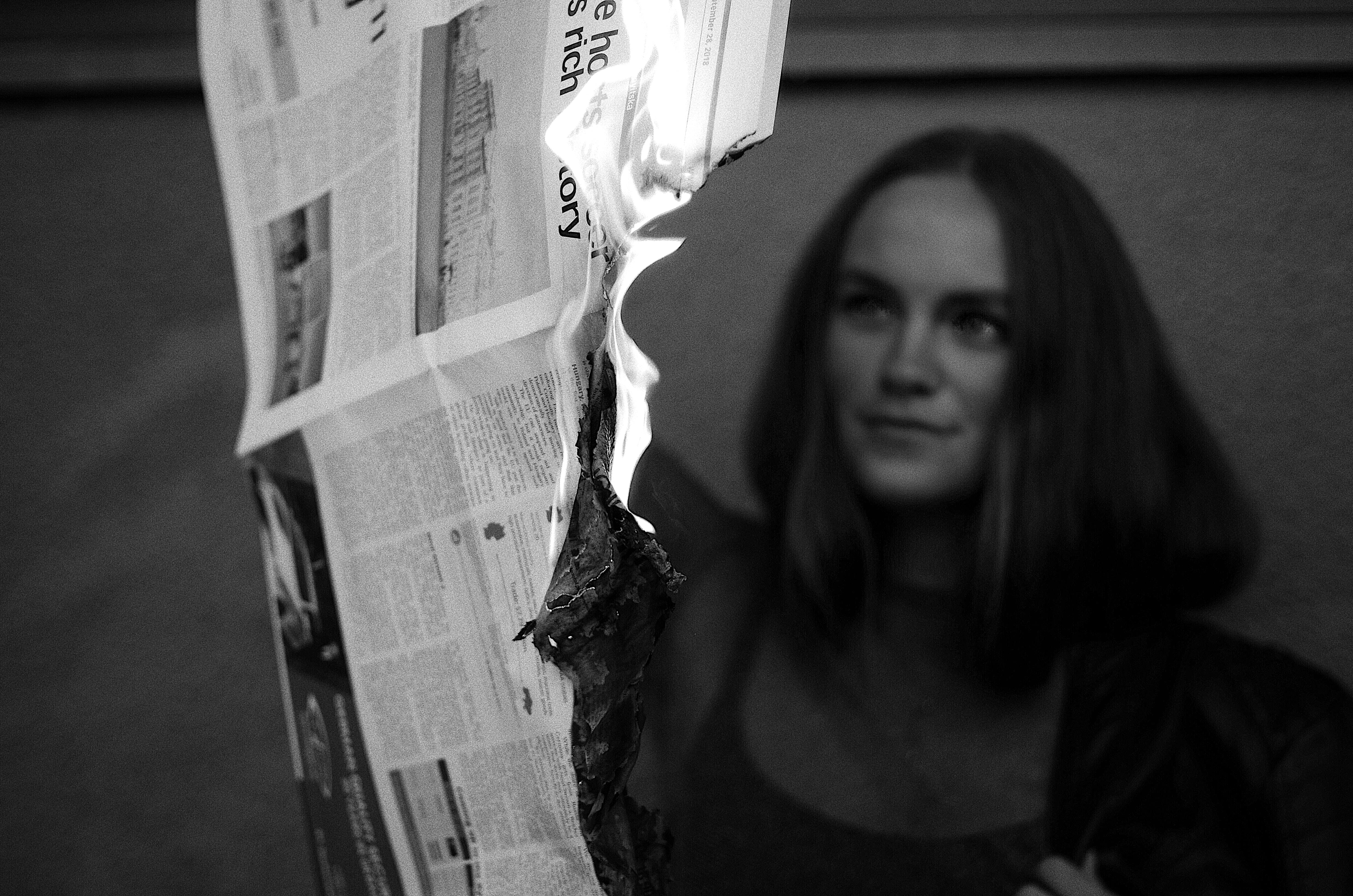 woman burning newspaper