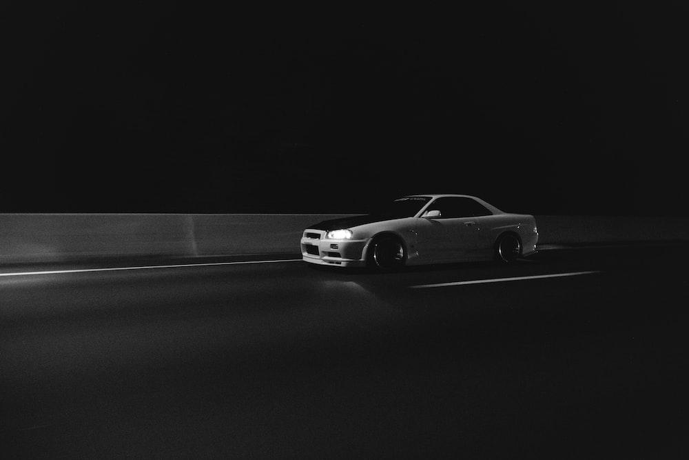 white car passing through streets