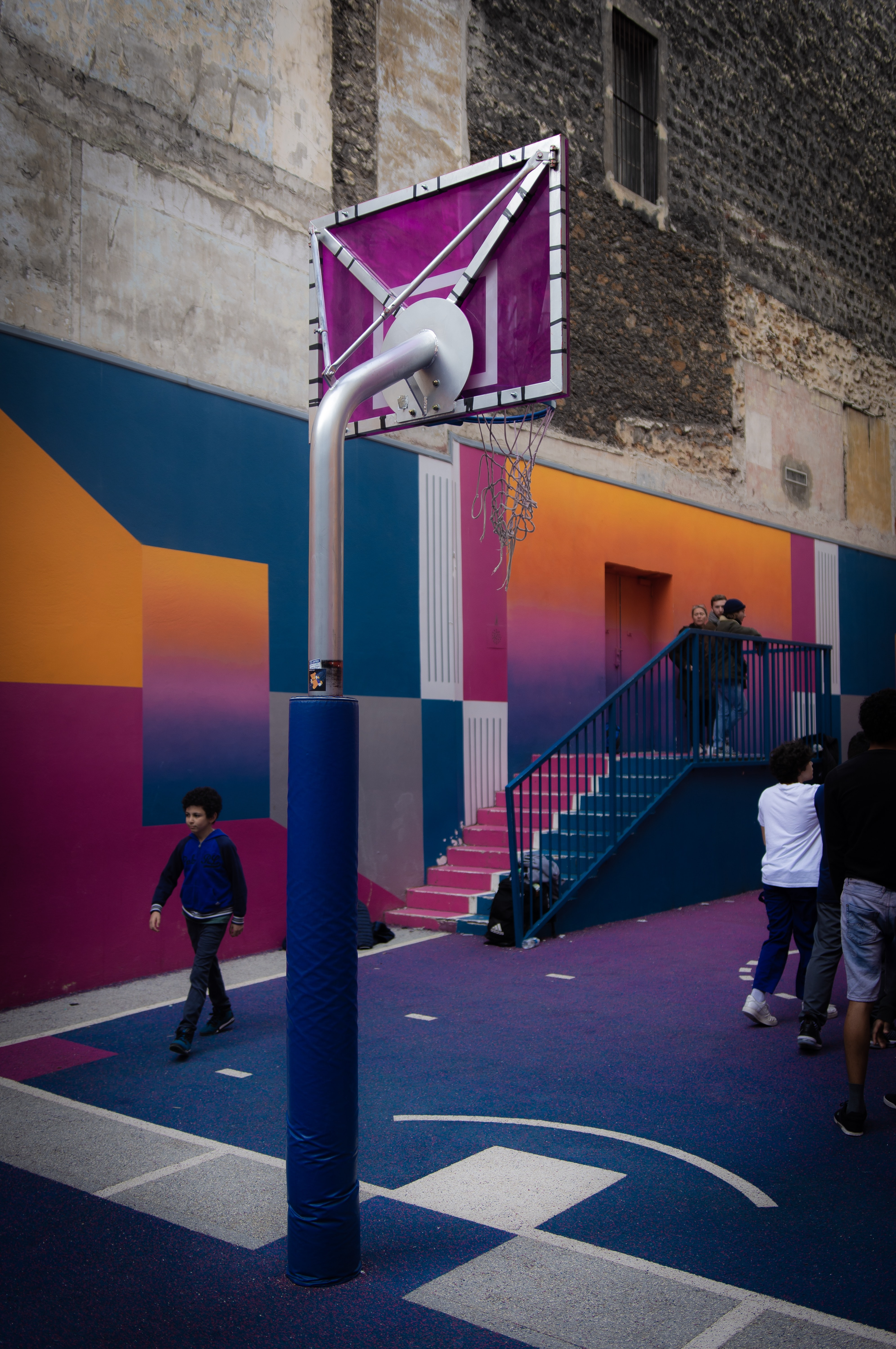 people standing in basketball court