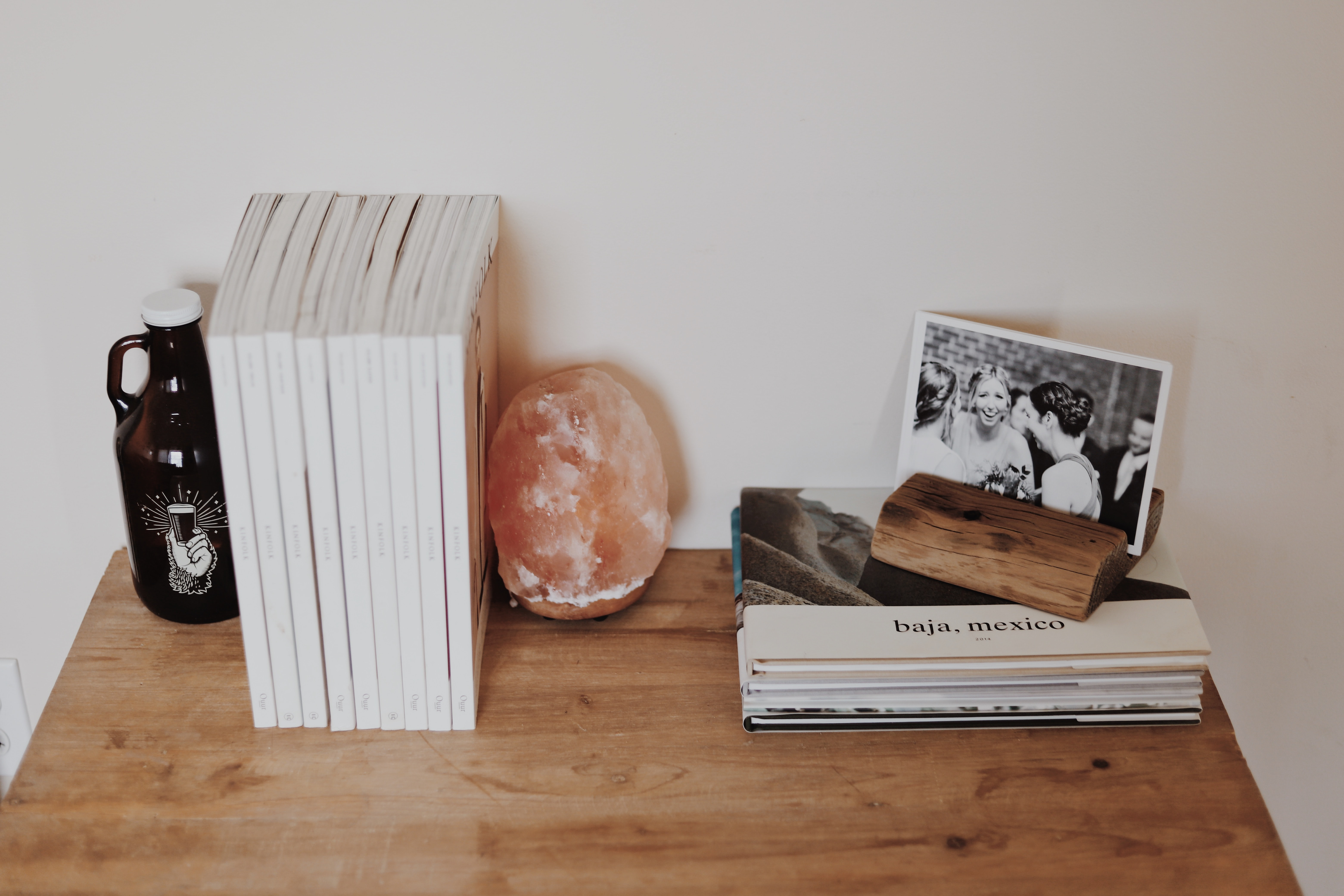 pile of books on brown wooden surface