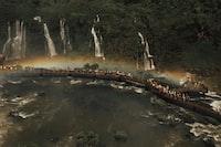 aerial view of people on brown bridge near waterfalss
