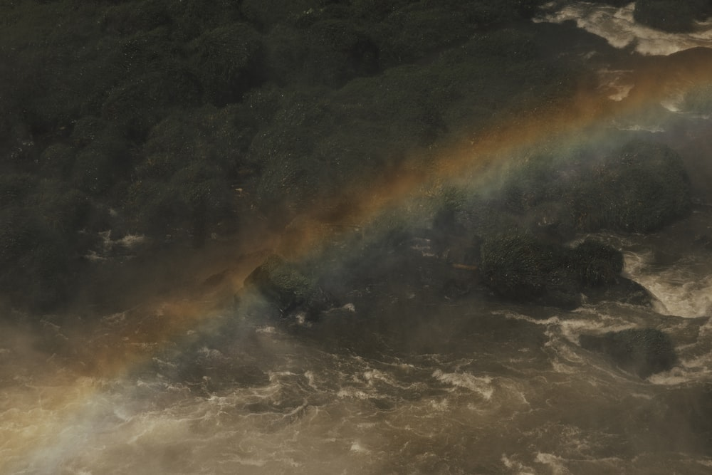 aerial view of island with rainbow