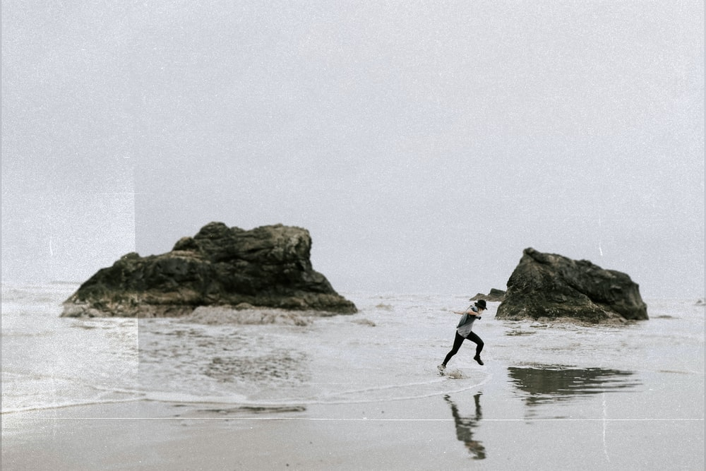 man running on beachside