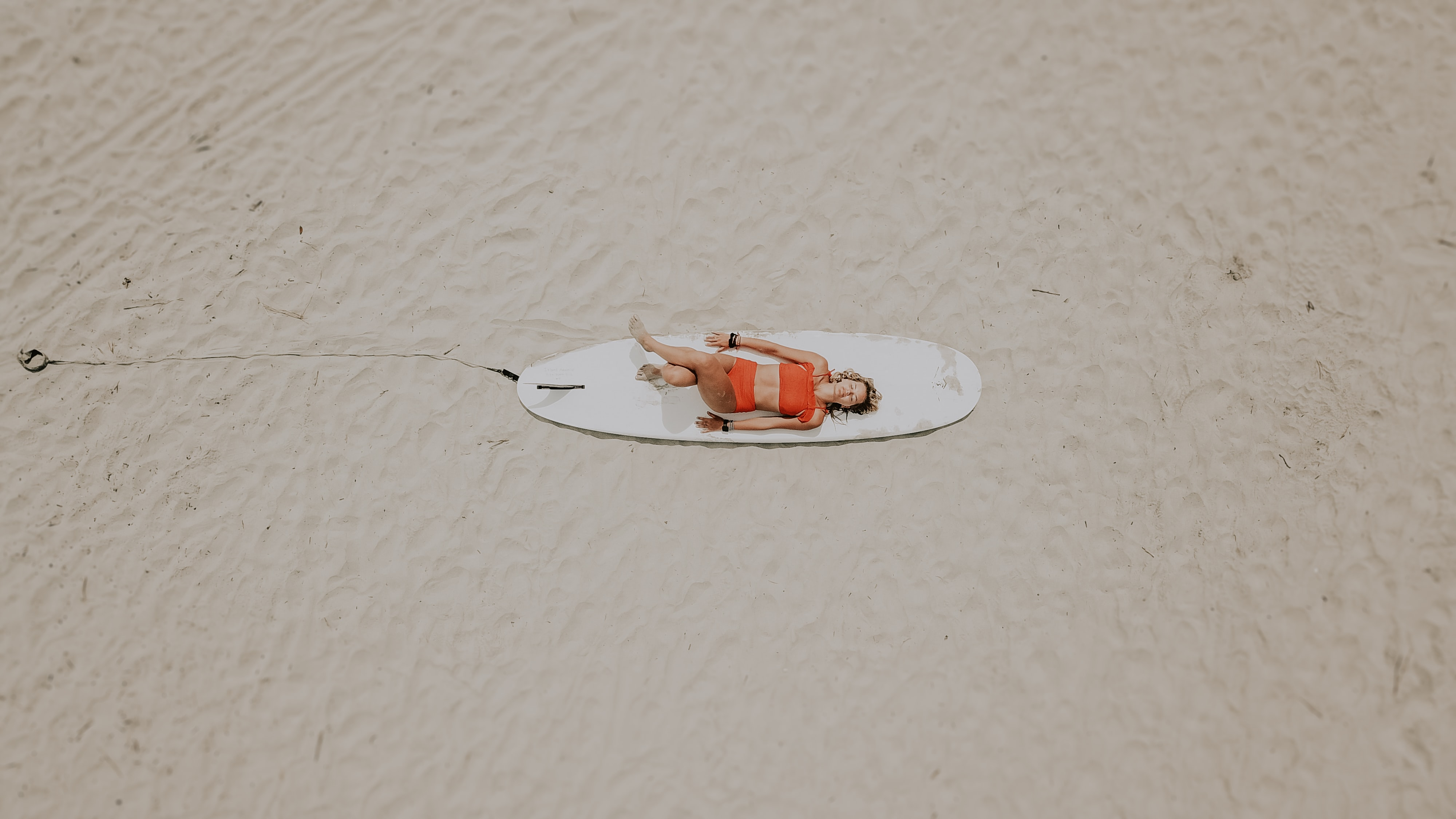 woman on white surfboard