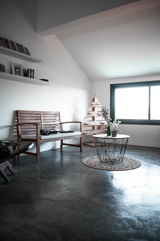 brown wooden danish couch near window