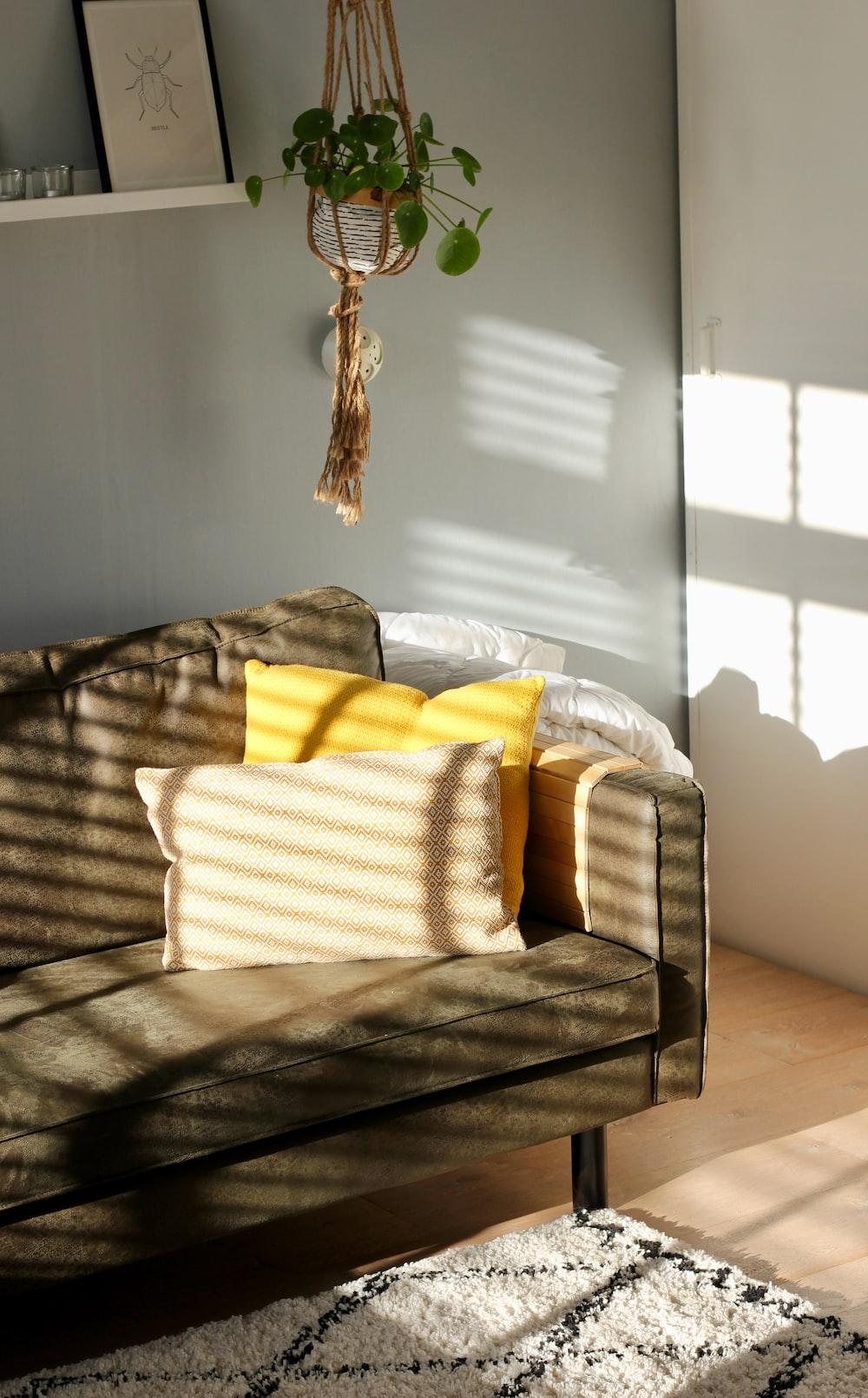 two white and yellow pillows on gray sofa