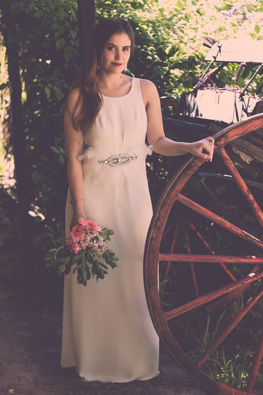 woman standing near wheel