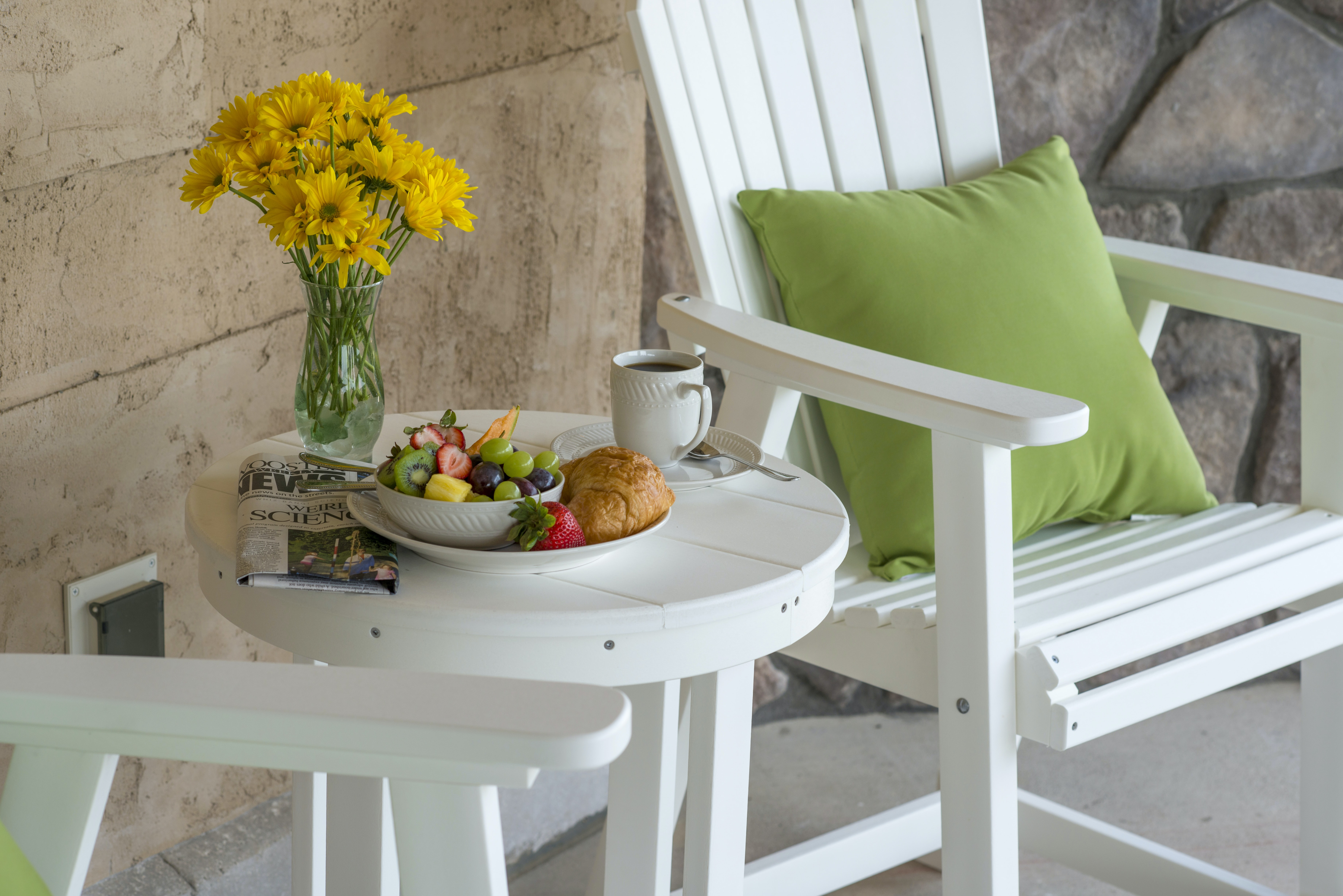 round white wooden coffee table and white wooden folding chair