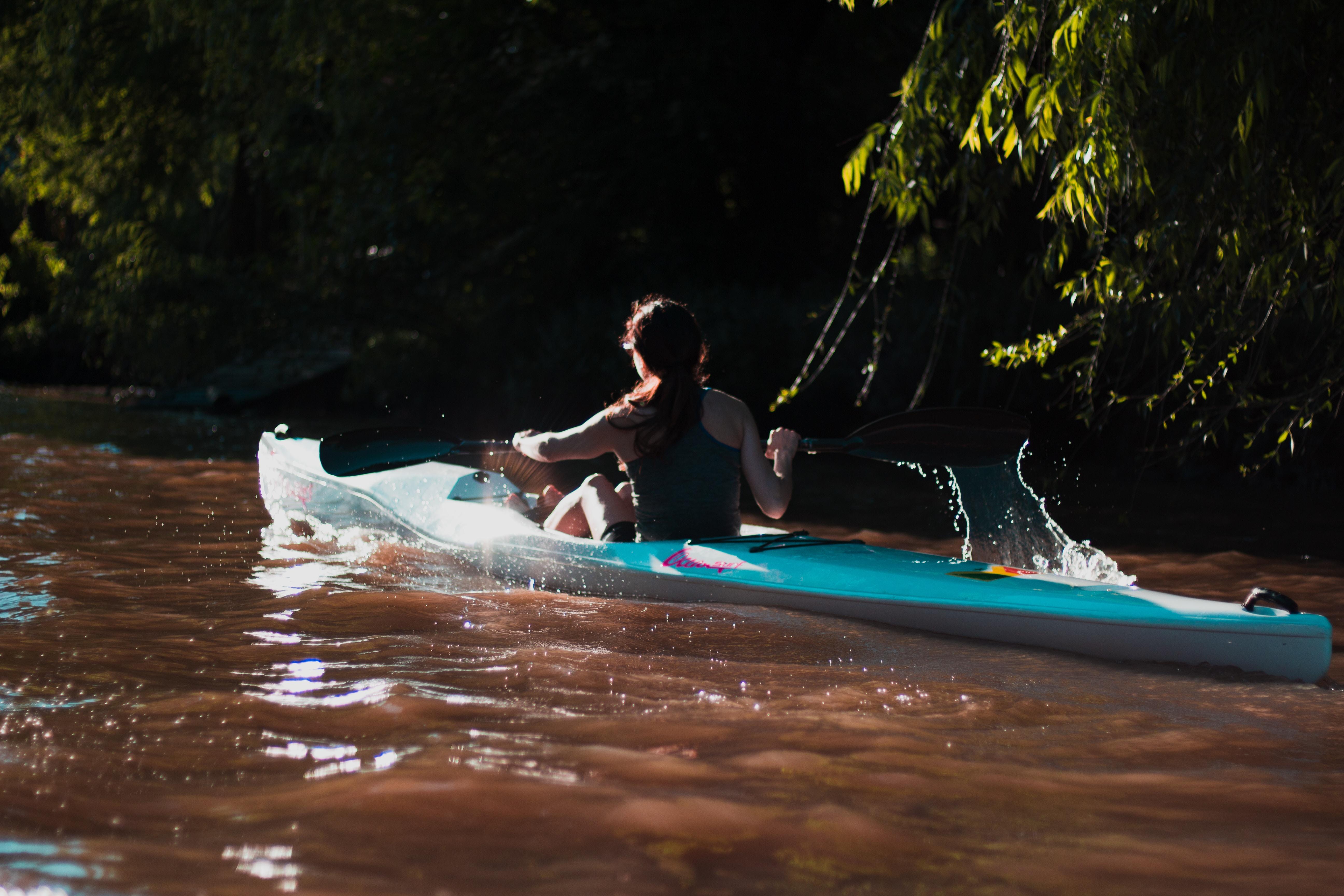 woman paddling through river
