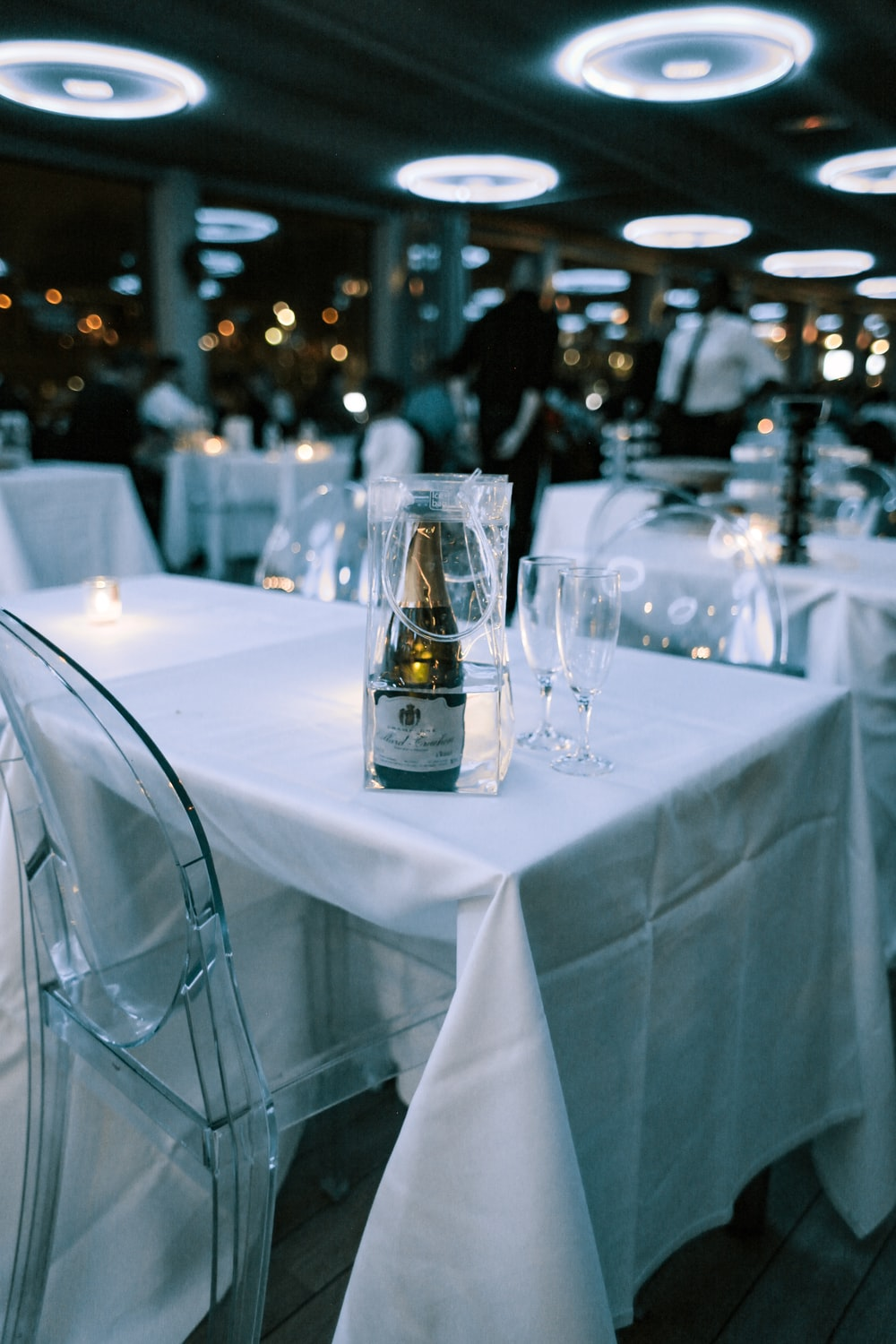 white labeled bottle on table