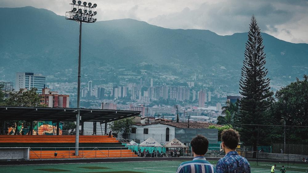 men standing on sports field