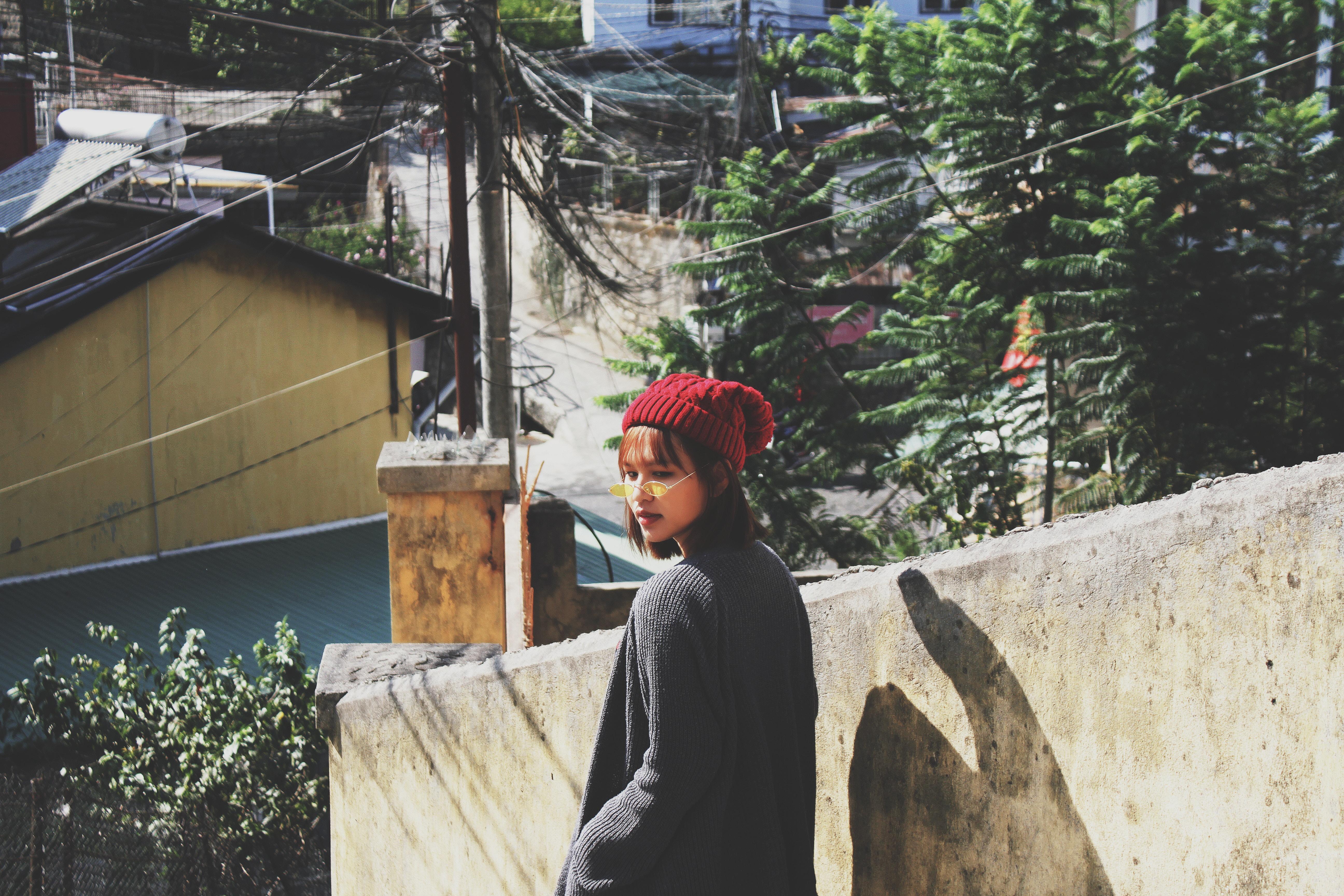 woman wearing maroon knit cap