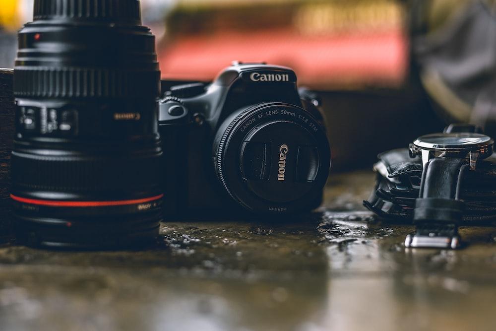 selective focus photo of black Canon DSLR camera