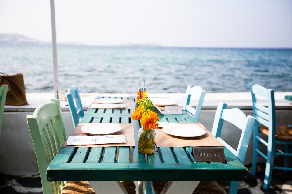 plates on dining tables by the sea