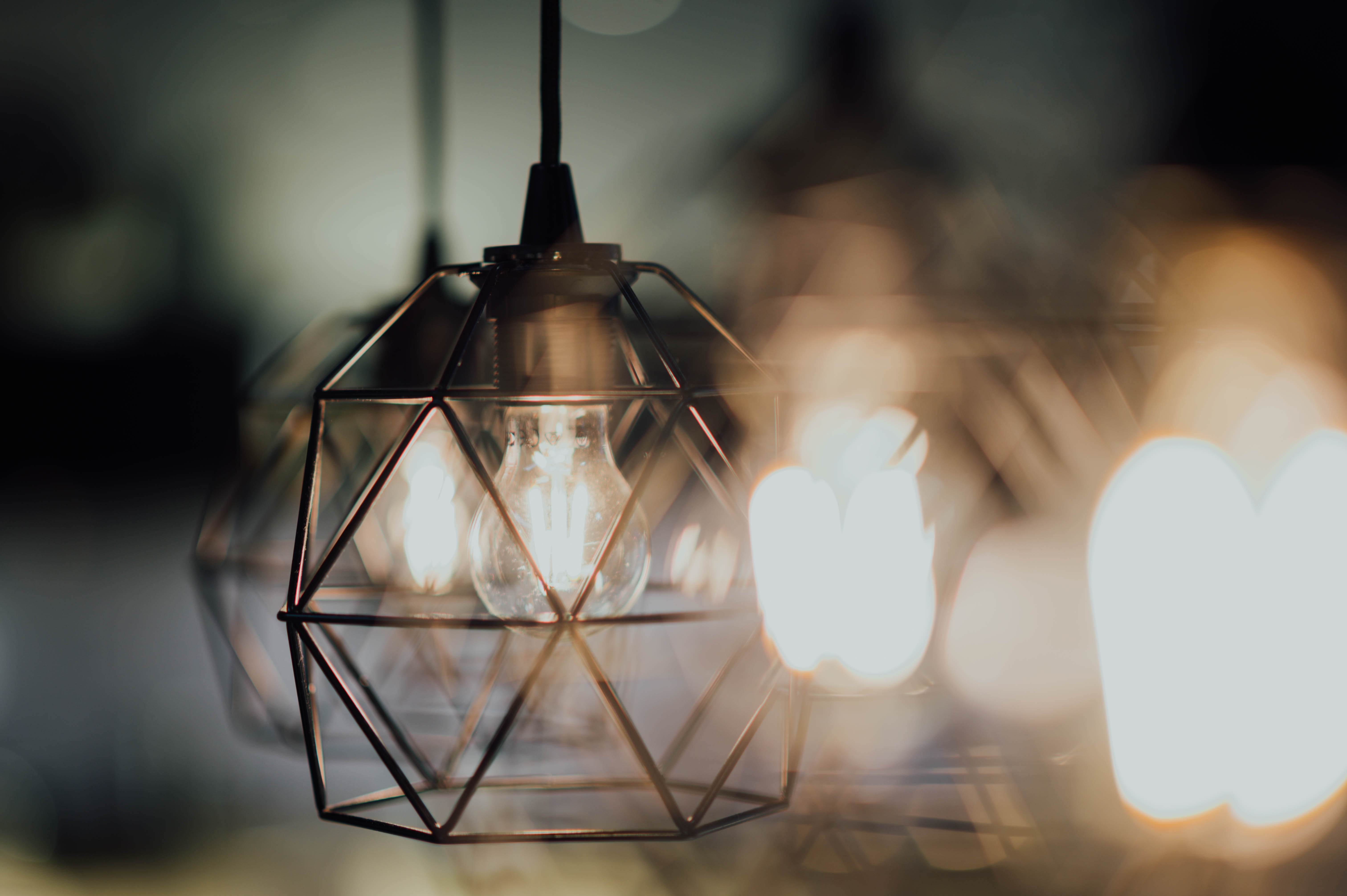selective focus photography of brass-colored pendant lamp
