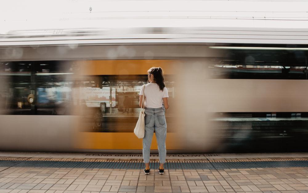 woman standing on pavement