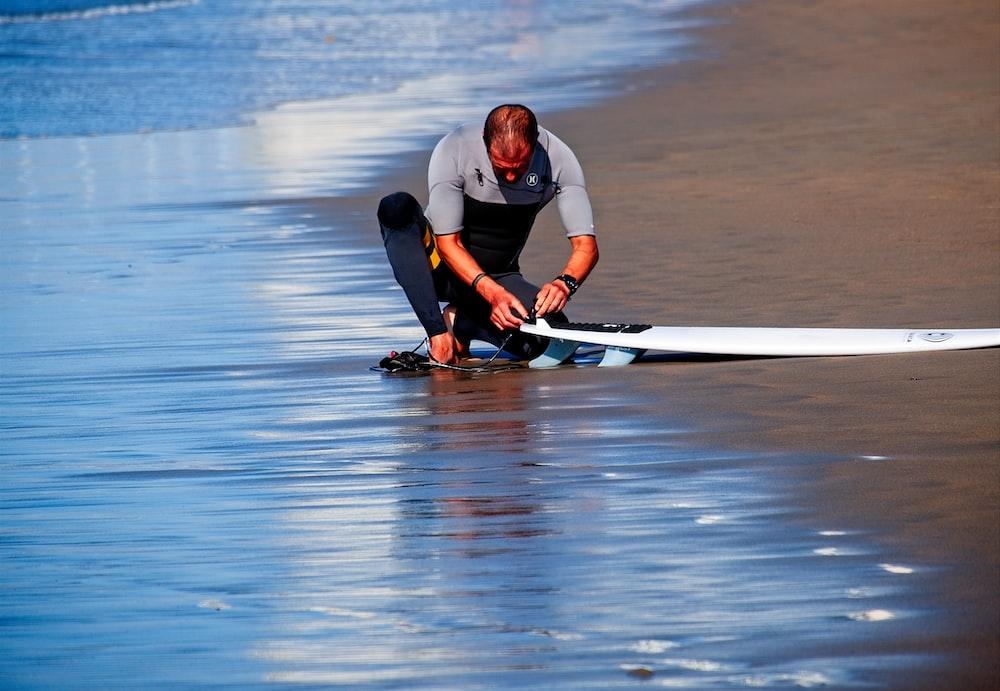 man holding surf board