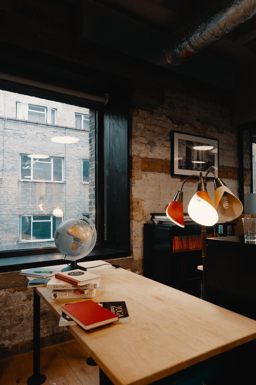 navigating desk globe on table near the window