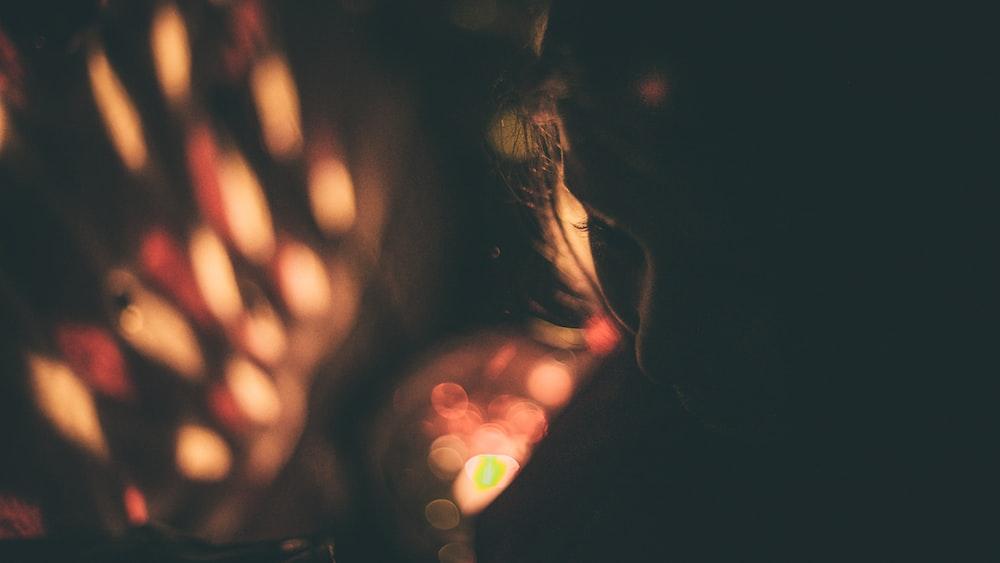 bokeh photography of woman silhouette