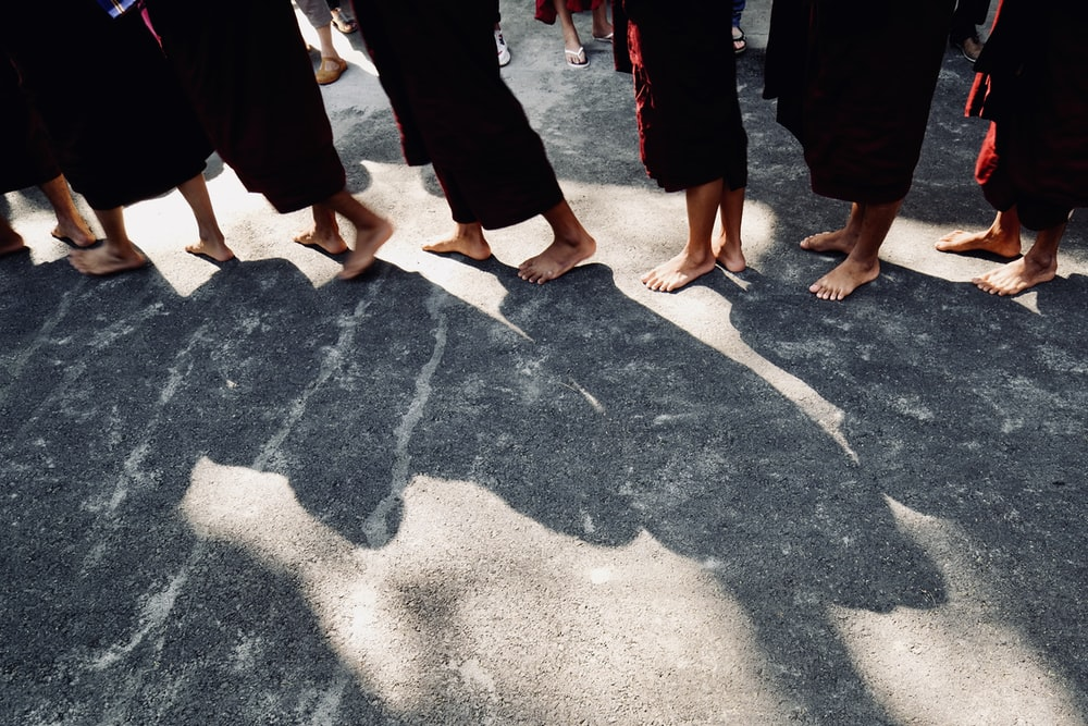 group of people standing at concrete ground