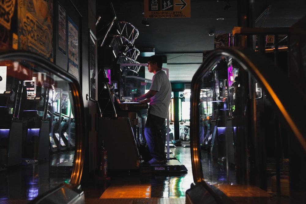 man playing on game arcade