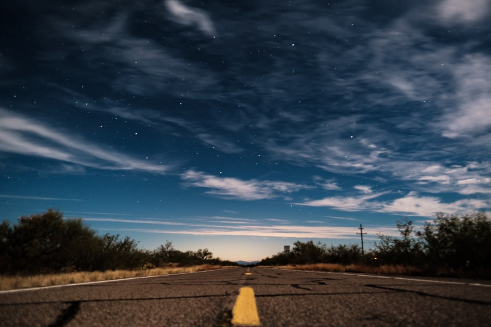 gray asphalt road under clear blue sky