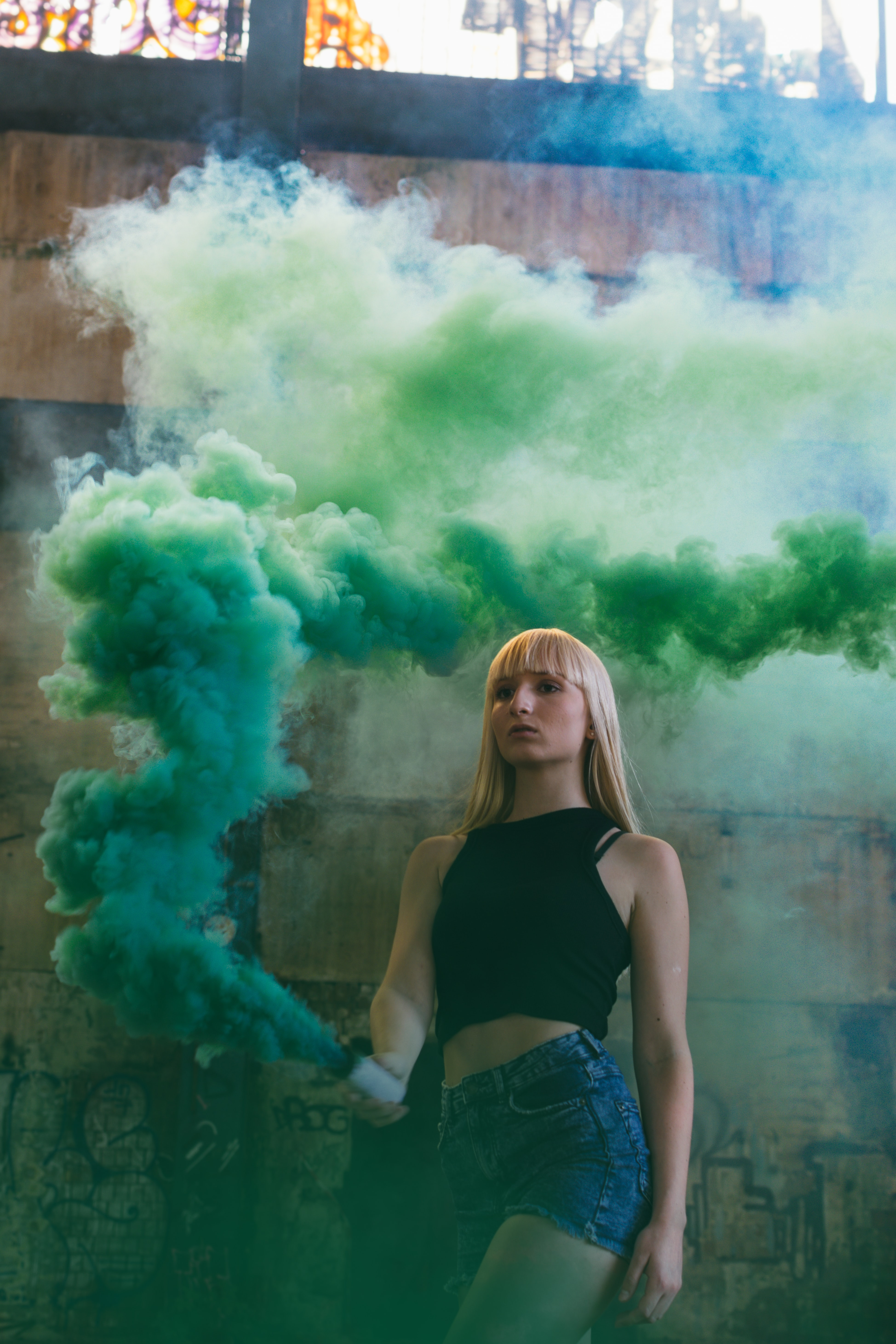 woman holding green smoke container
