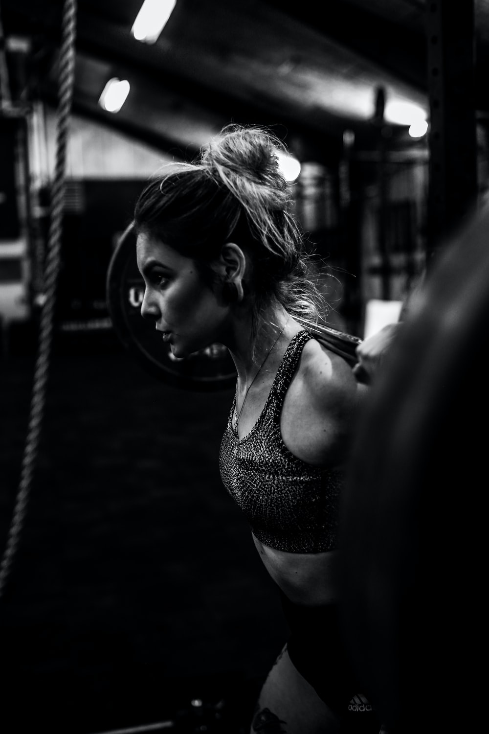 greyscale photo of woman in bralette inside room photo – Free Fitness Image  on Unsplash