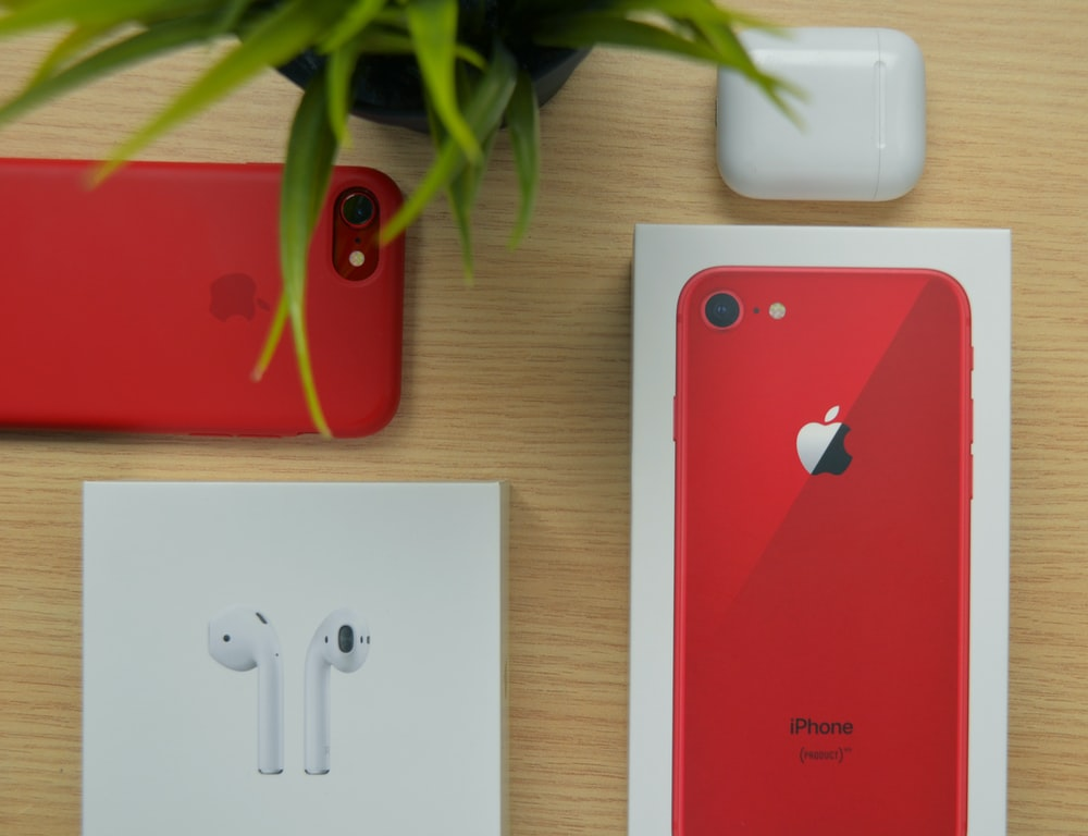 PRODUCT RED iPhone 7 with box on table