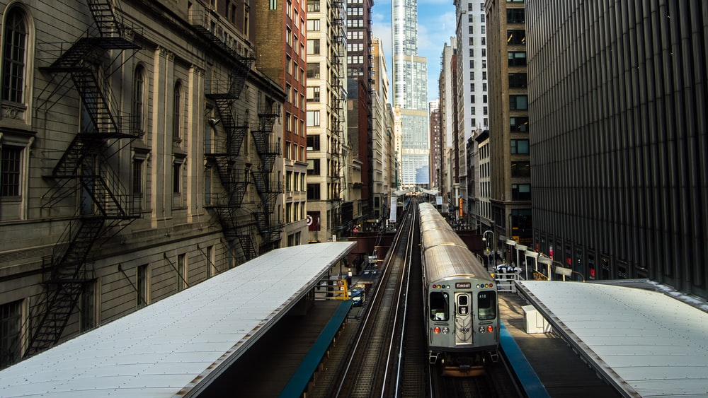 train surrounded by buildings during daytime
