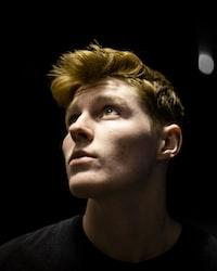 man in black with blonde hair