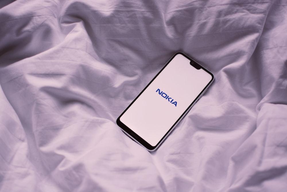 black Nokia phone on white textile