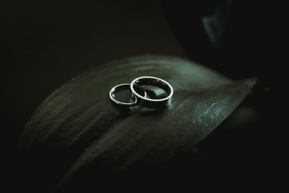 silver-colored rings