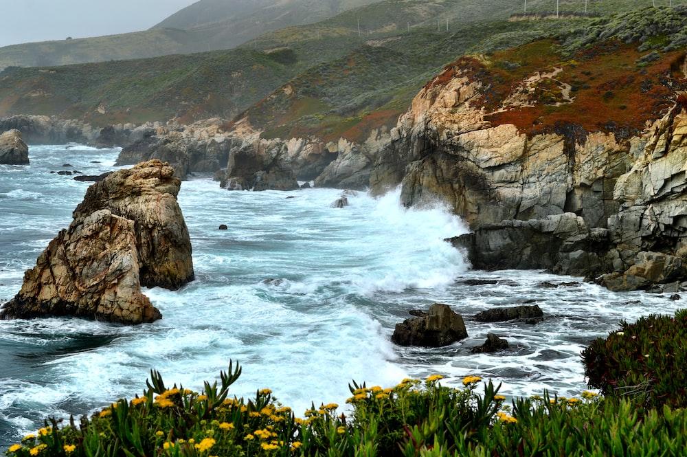 sea waves through boulders