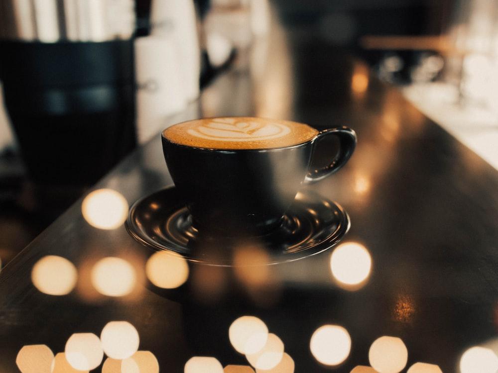 shallow focus photo of latte