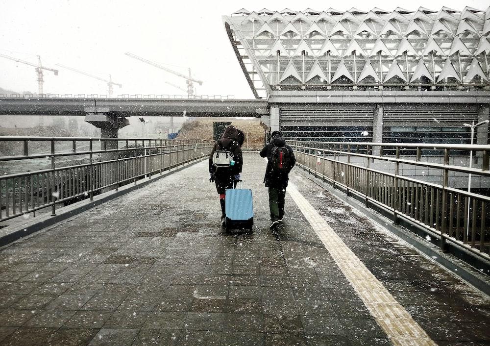 two people walking along pathway