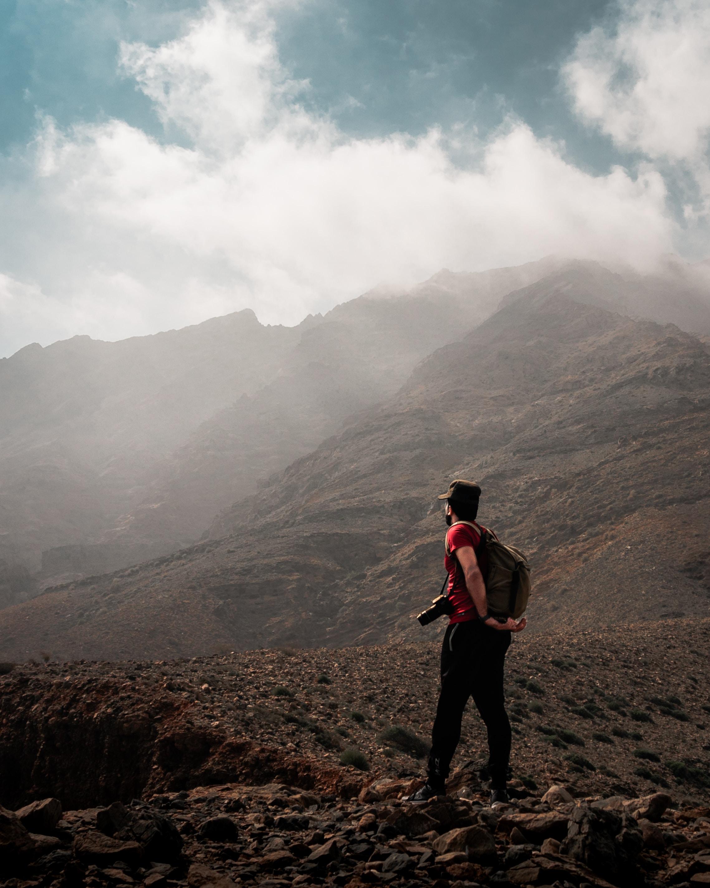 man overlooking mountain ranes