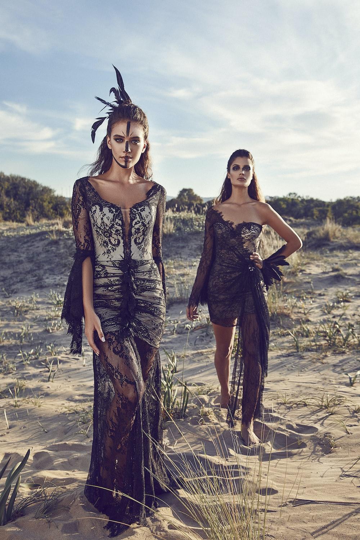 women wearing black lace dresses in dessert
